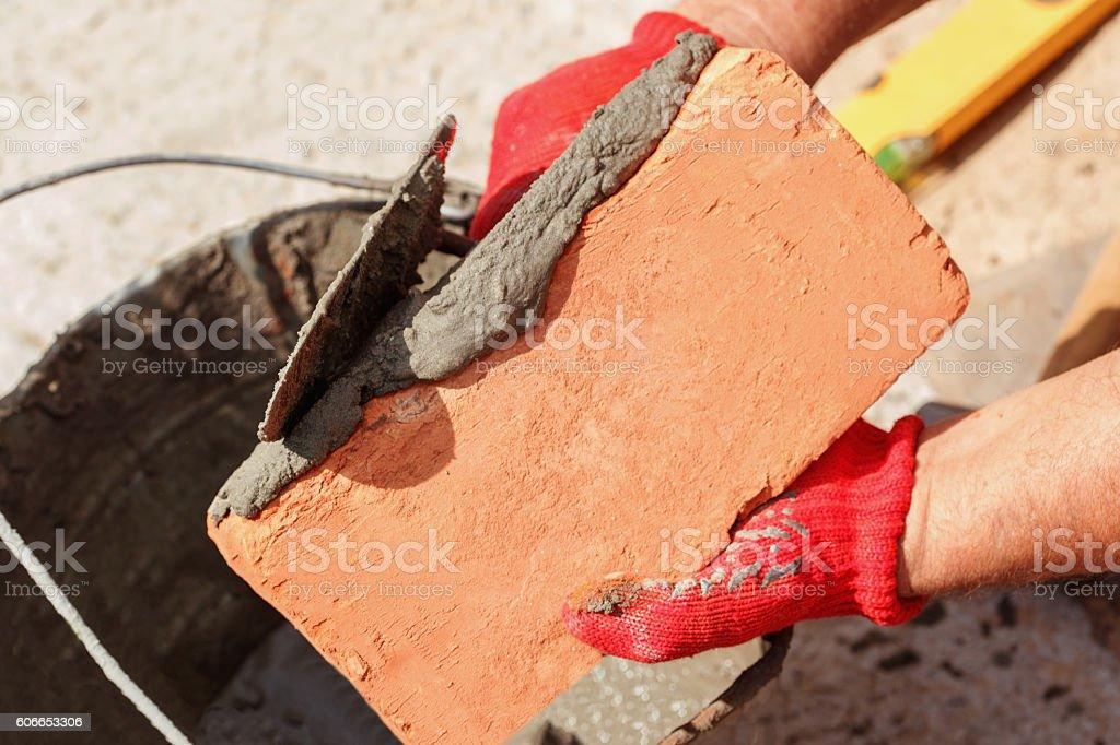 Bricklayer with brick stock photo