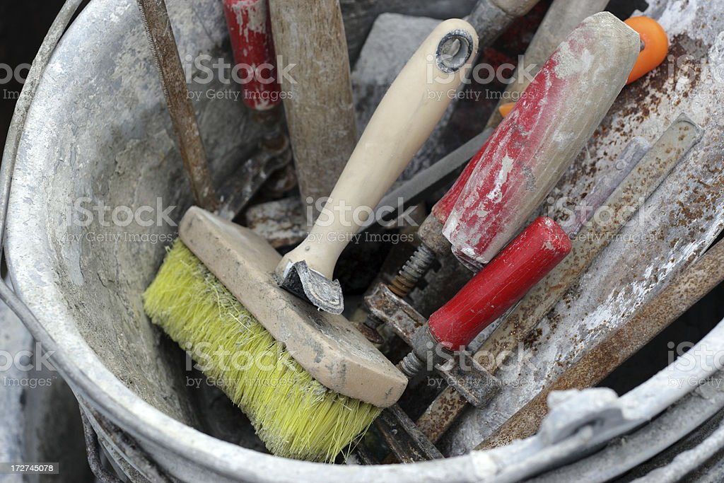 Bricklayers bucket with tools. royalty-free stock photo