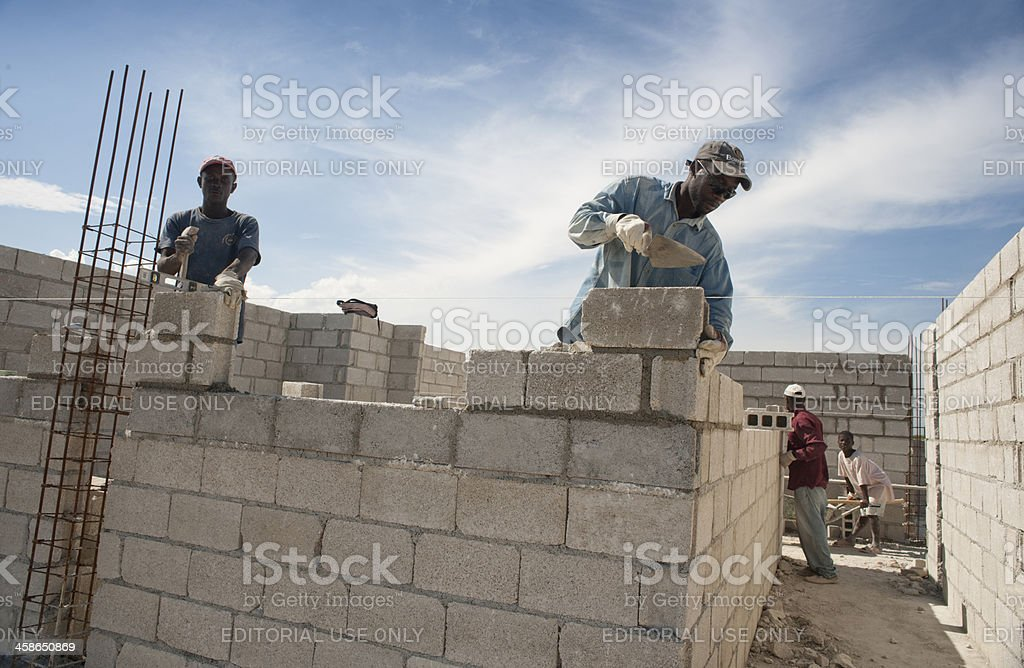 Bricklayers building a new house stock photo