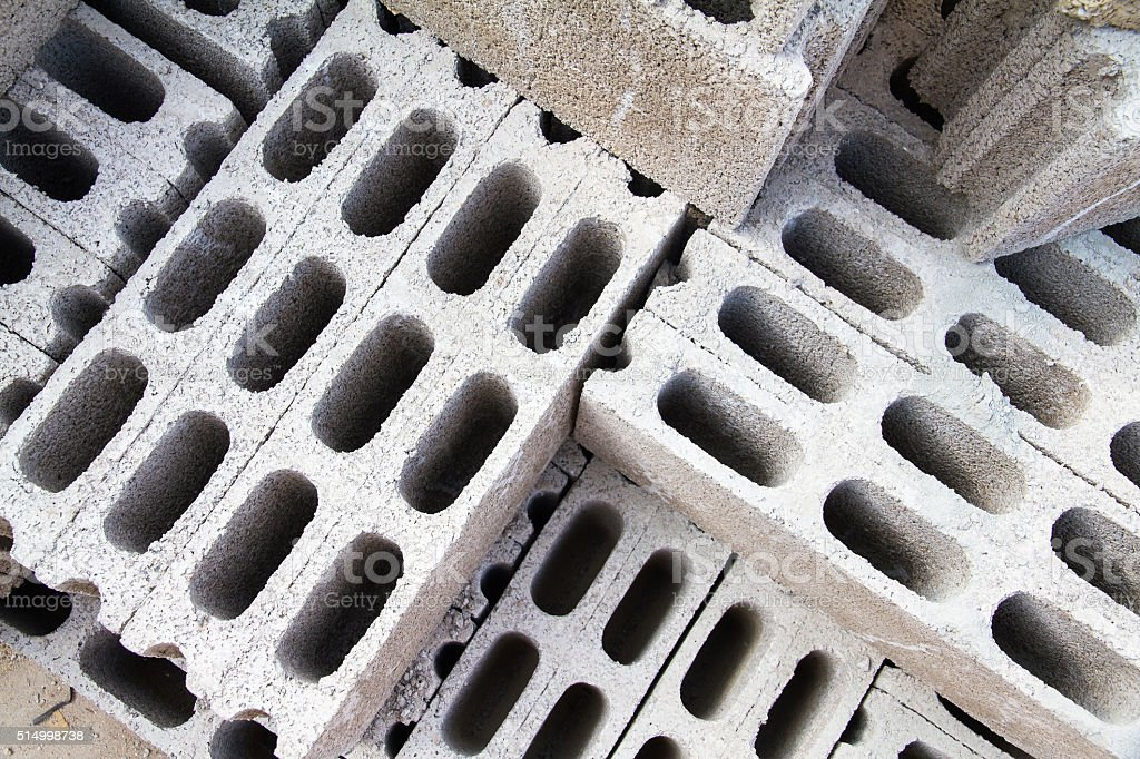 Bricks made of concrete for building of houses and fences stock photo