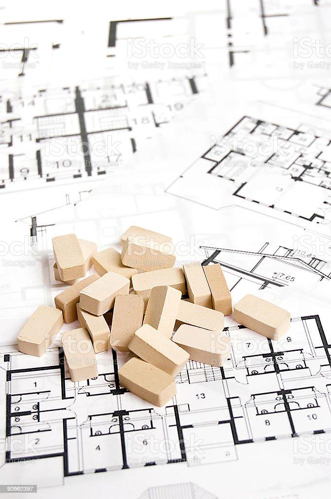 Bricks over blueprint royalty-free stock photo