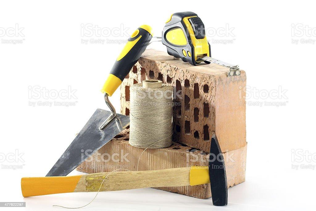 Bricks, trowel and hammer royalty-free stock photo