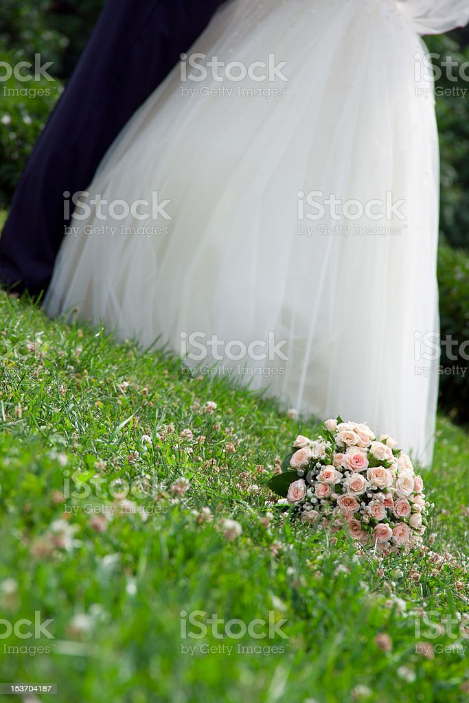 bridal bouquet lies on the grass stock photo