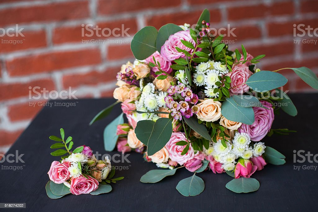 bridal bouquet of fresh flowers and grooms boutonniere o stock photo