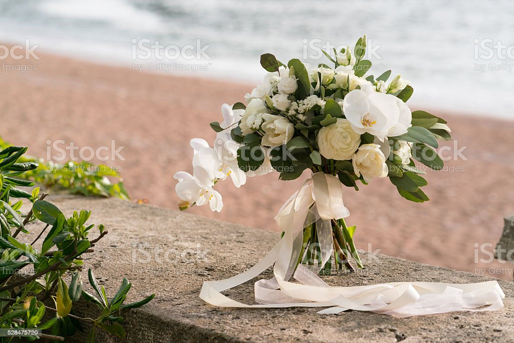 bridal bouquet of orchids, ranunculuses, tulips and eucalyptus stock photo