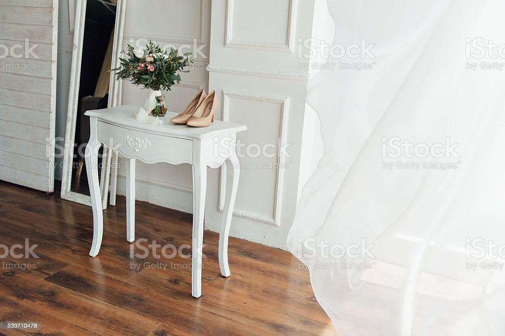 bridal bouquet of peones with white shoes stock photo