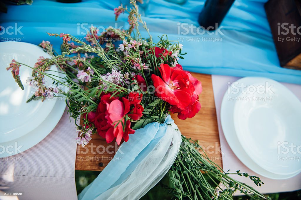 Bridal bouquet of wild flowers on a wedding table stock photo