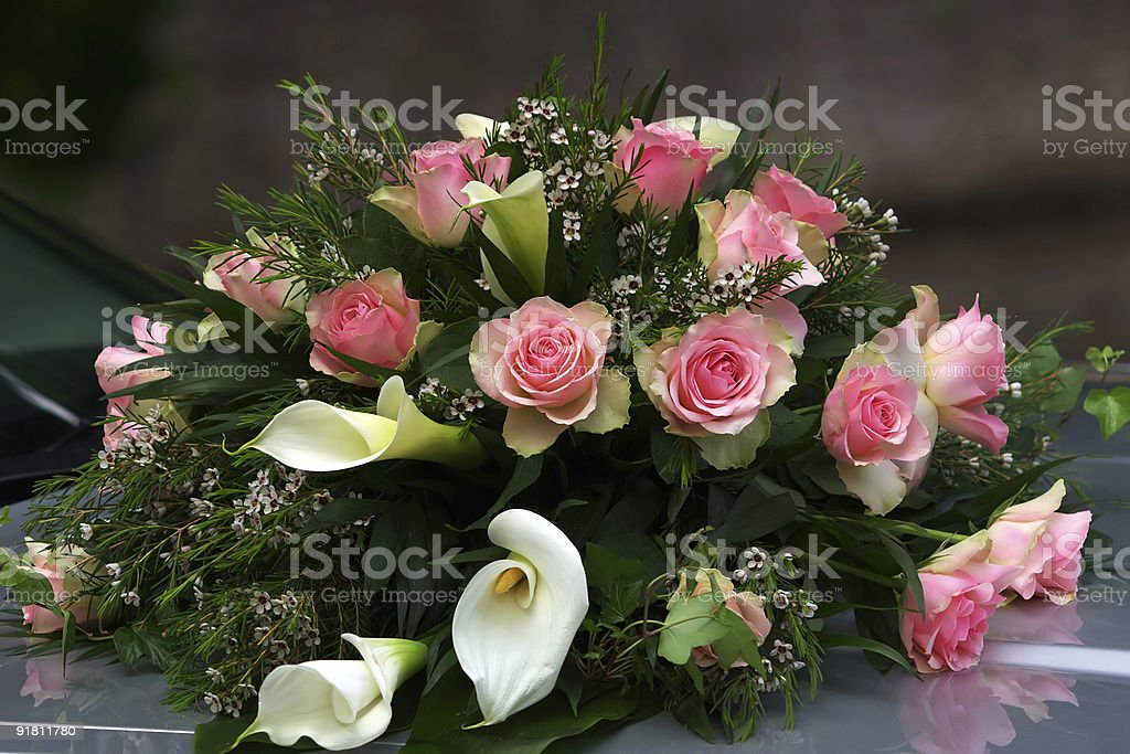 bridal bouquet on a front hood royalty-free stock photo