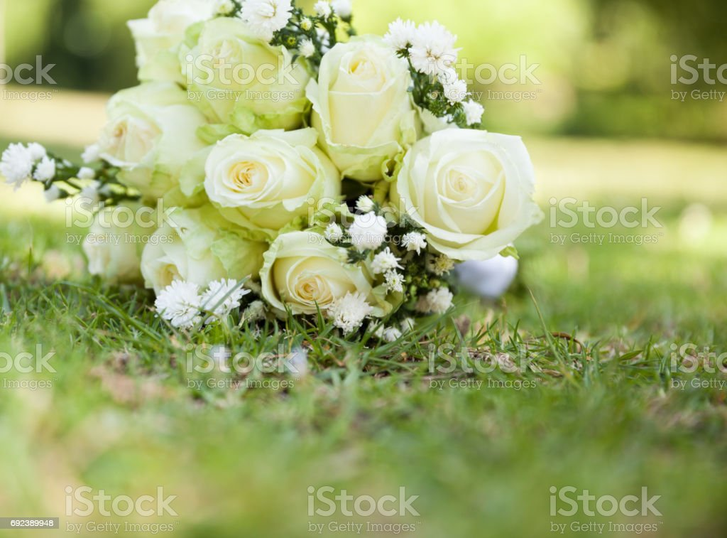 Bridal bouquet on grass at the park stock photo