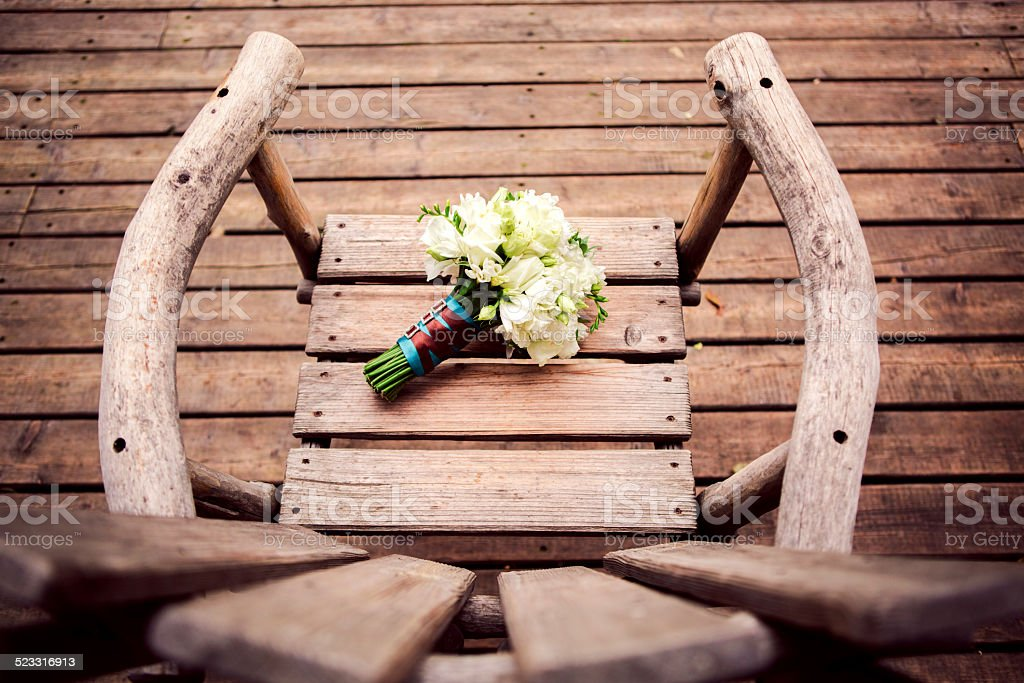 bridal bouquet on old wooden chair royalty-free stock photo