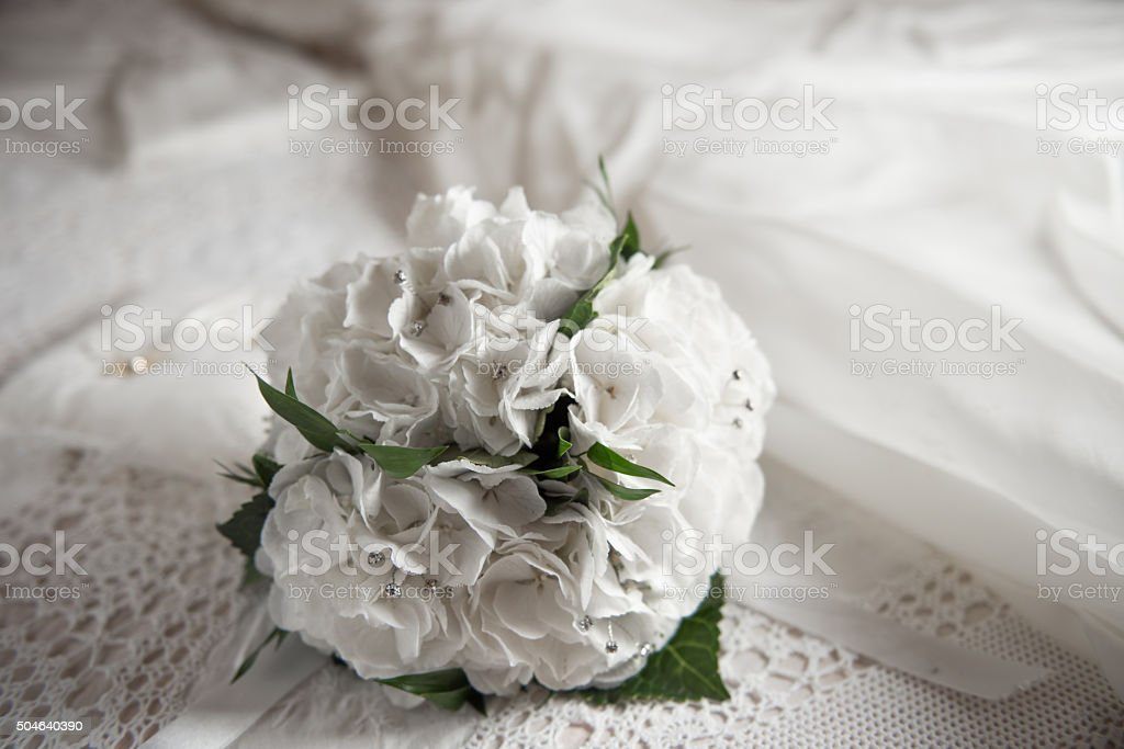 bridal bouquet on the bed stock photo