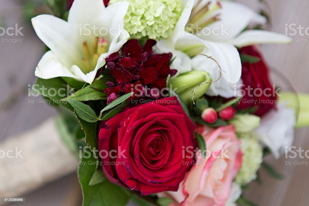 Bridal bouquet with roses and lilies stock photo