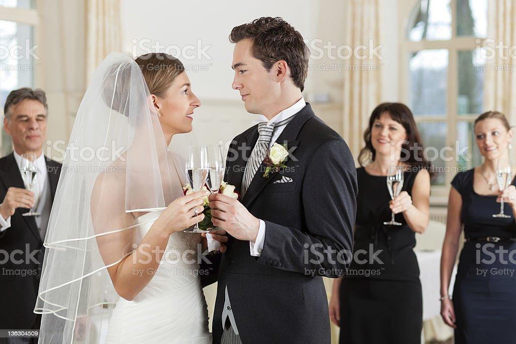 Bridal couple clinking glasses royalty-free stock photo