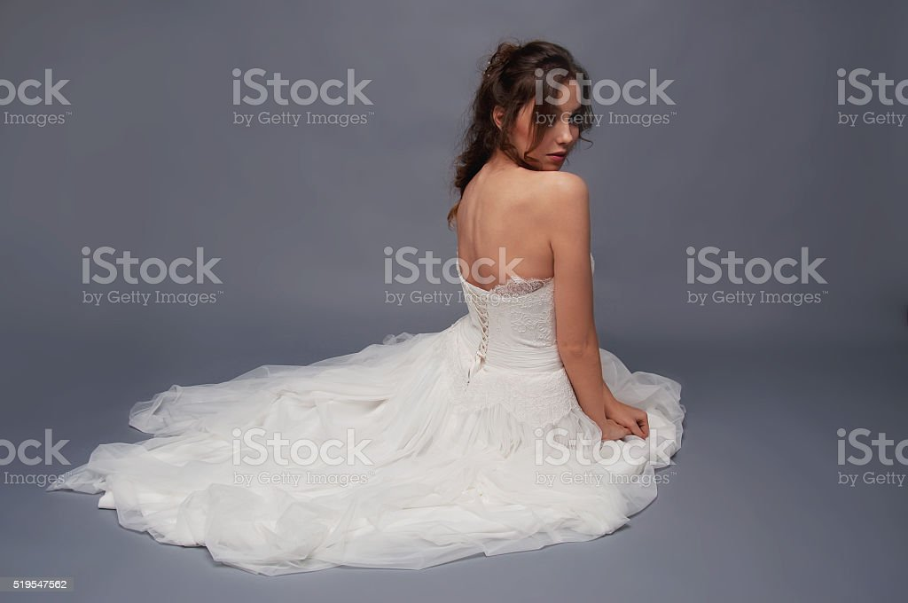 Bridal fashion. Brunette bride view from the back. stock photo