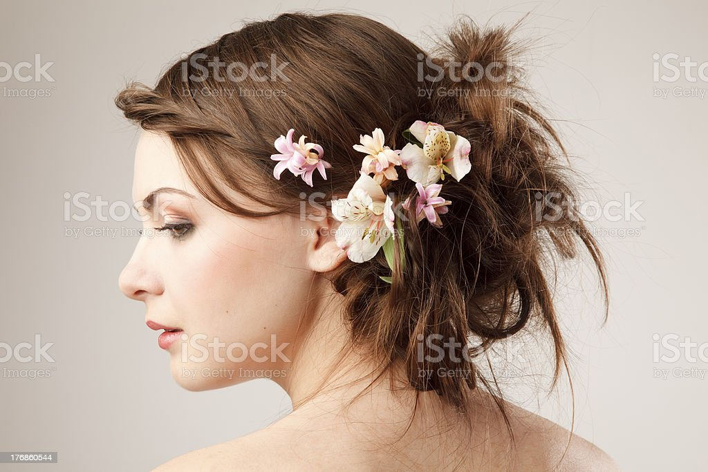 Bridal hairstyle with real flowers royalty-free stock photo