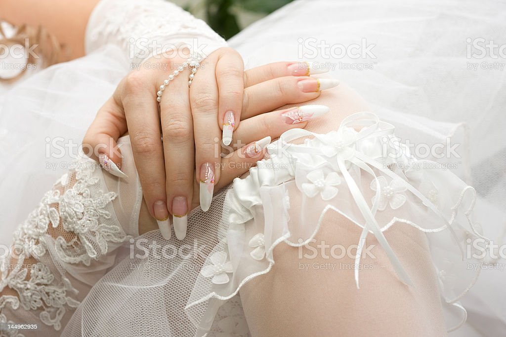 Bridal manicure and garter royalty-free stock photo