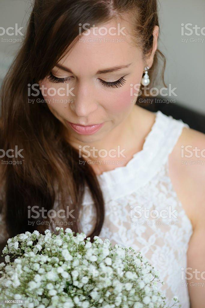 Bridal portrait caucasian female looking down retro vintage lace dress stock photo