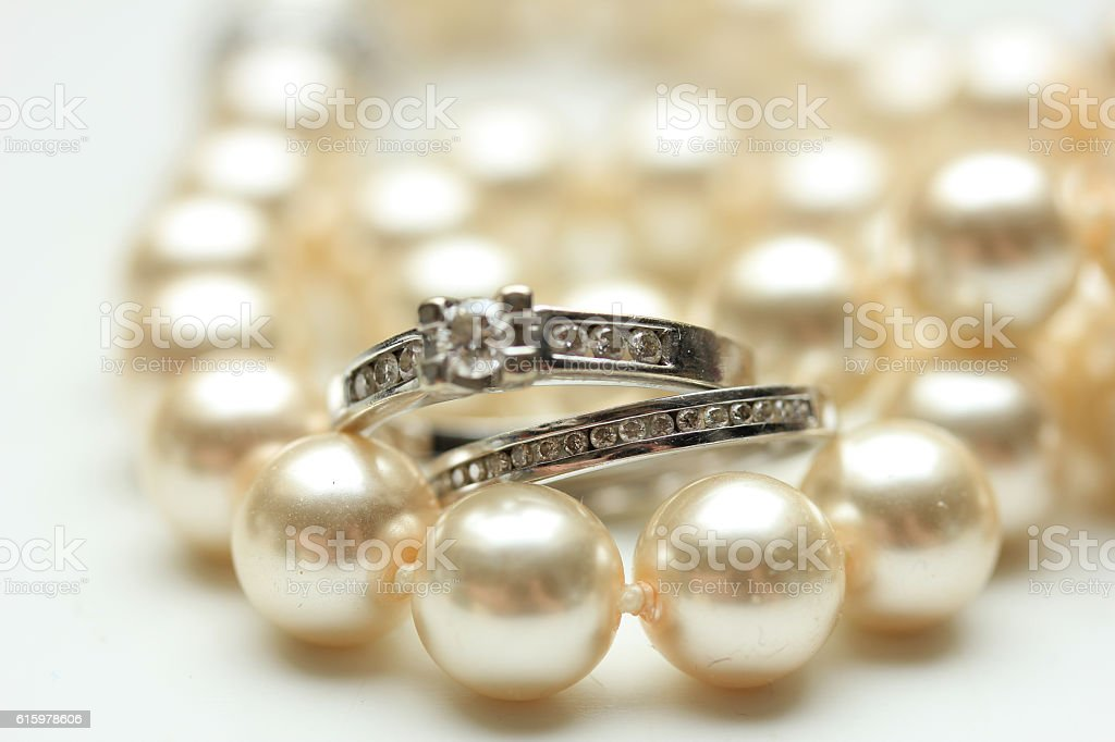 Bridal rings on pearls stock photo