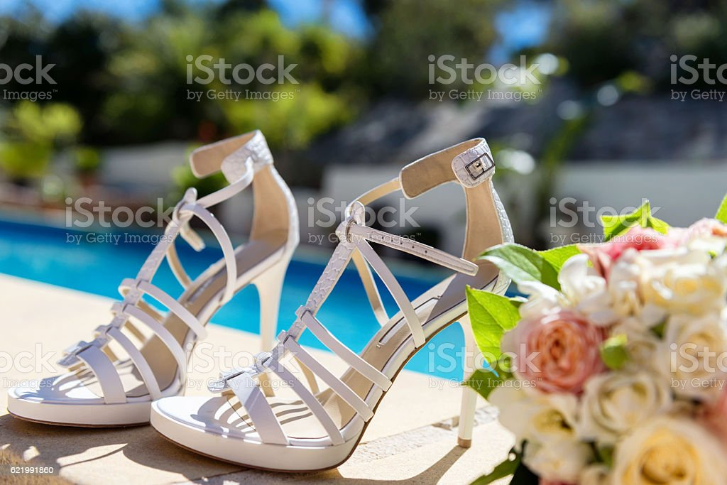 Bridal shoes and bouquet stock photo