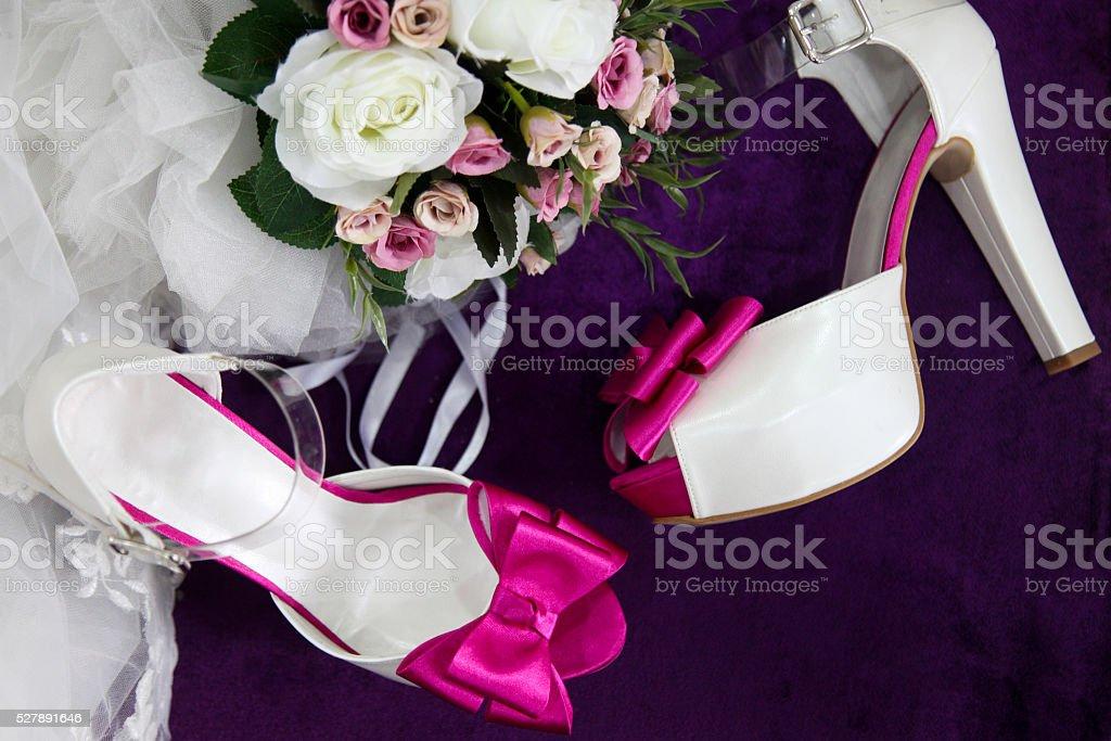 bridal shoes and bridal bouquet