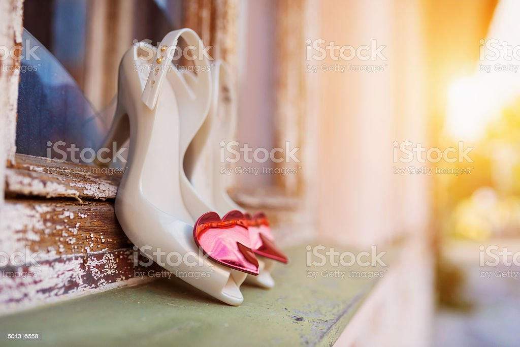Bridal shoes on window parapet stock photo