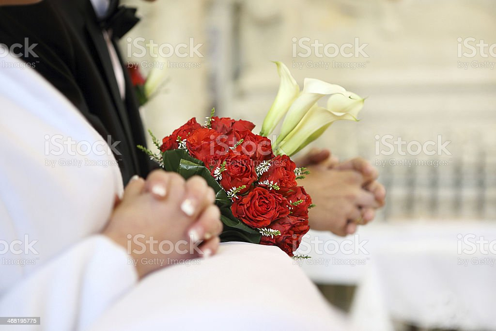 Bridal wedding bouquet lying on the hassock stock photo