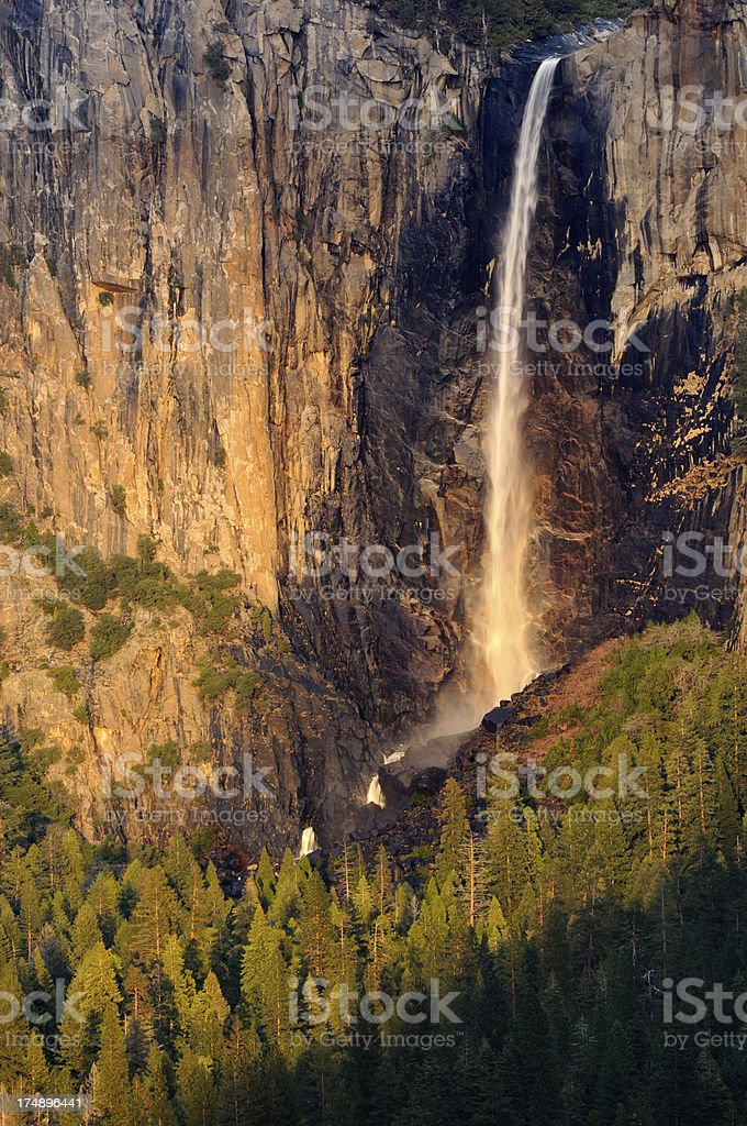 Bridalveil Falls litted by evening sun in Yosemity National Park royalty-free stock photo