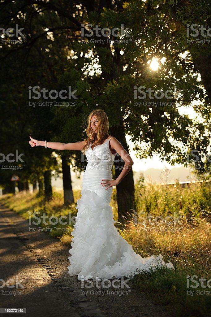 bride alone on road stock photo