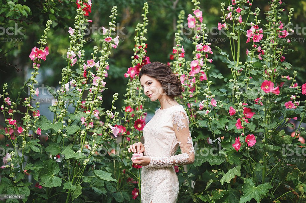 Bride among the flowers stock photo