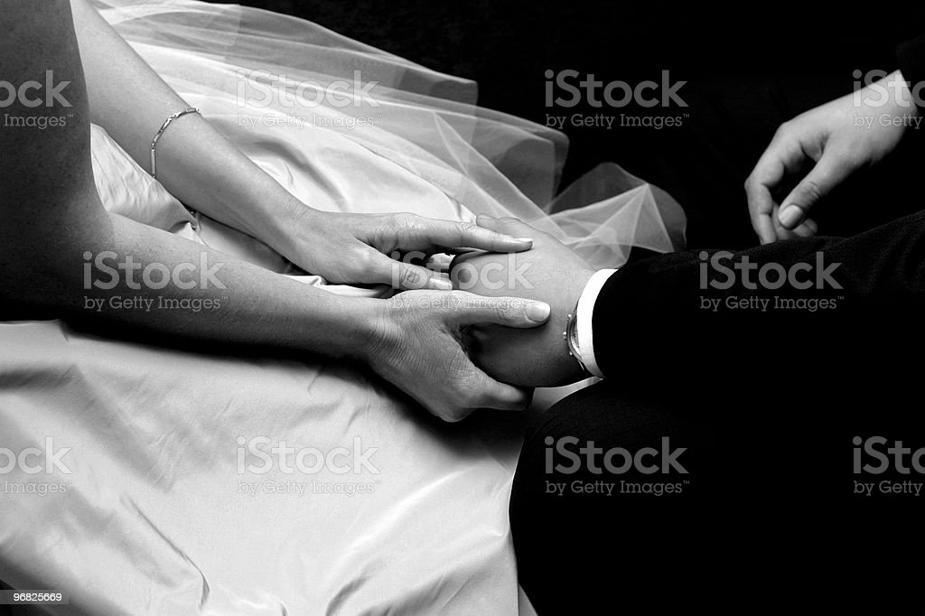 Bride and bridegroom holding hands stock photo