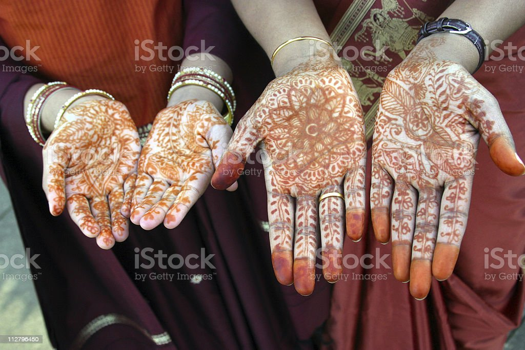 Bride and bridesmade with Henna Hands at traditional indian wedding royalty-free stock photo