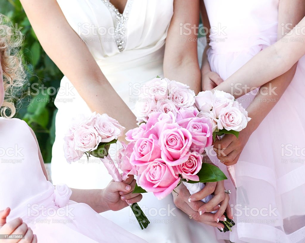 Bride and flower-girls with pink roses outside royalty-free stock photo