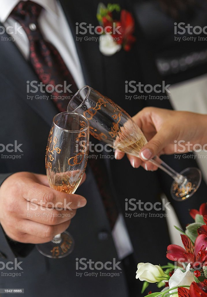 bride and groom a clink glasses. Wedding couple royalty-free stock photo