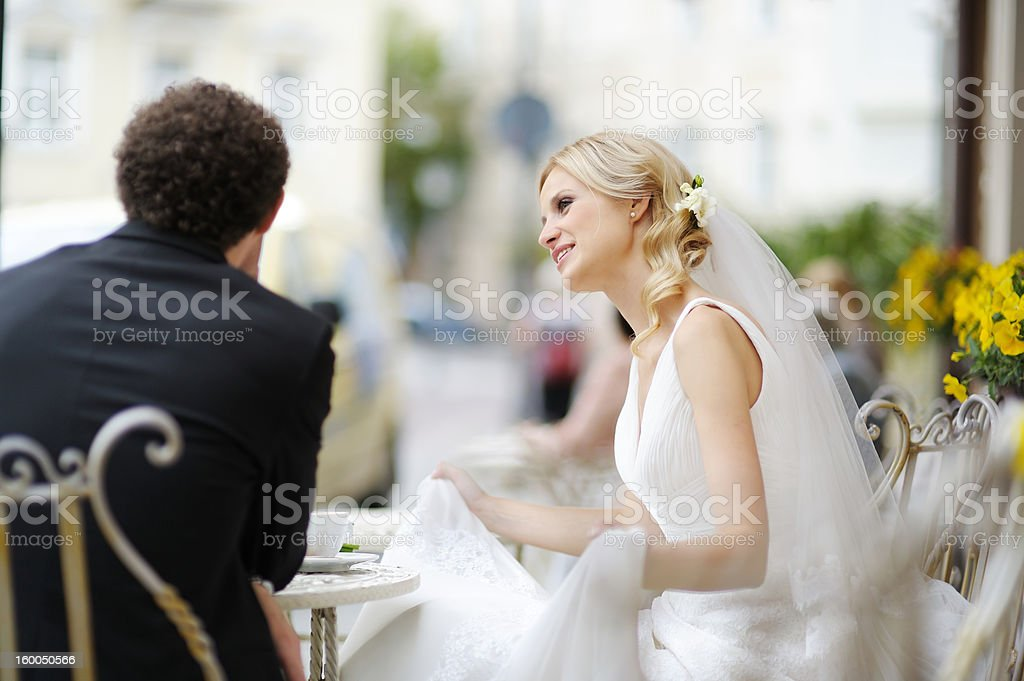 Bride and groom at outdoor cafe royalty-free stock photo