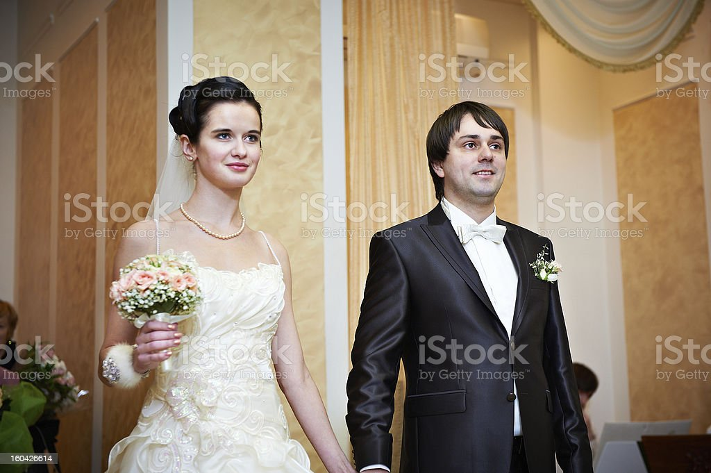 Bride and groom at the ceremony of marriage registration royalty-free stock photo