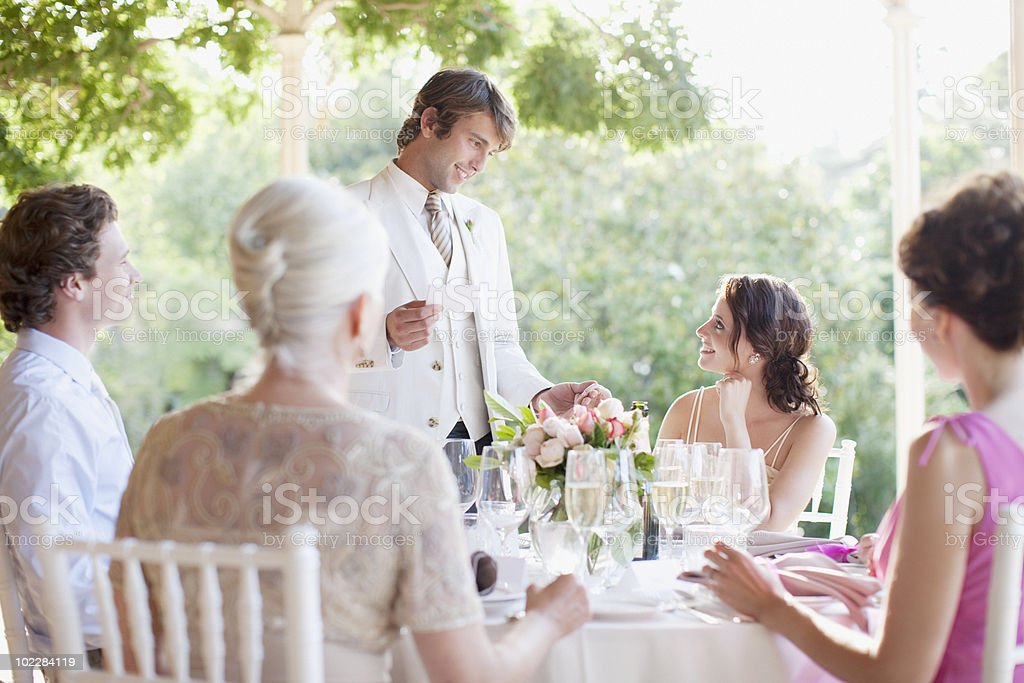 Bride and groom at wedding reception stock photo