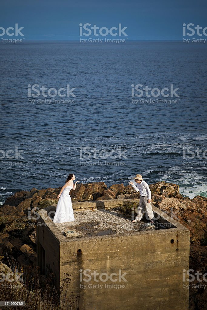 Bride and groom blowing a kiss royalty-free stock photo
