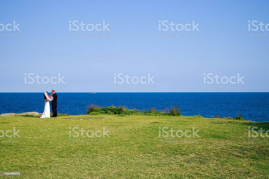 Bride and Groom by the Sea royalty-free stock photo
