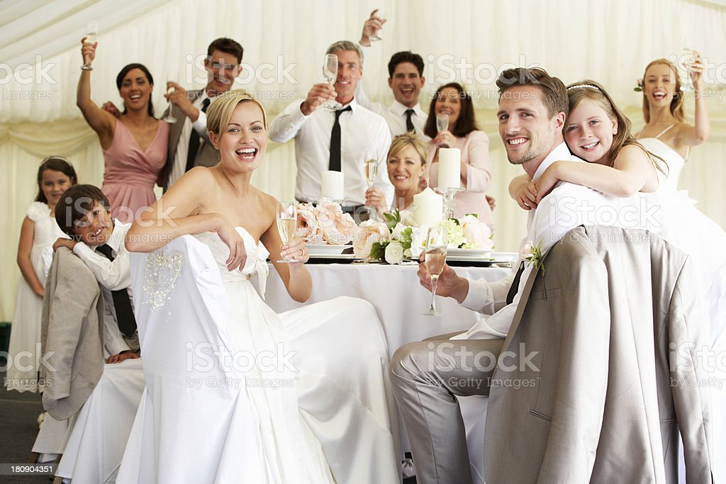 Bride And Groom Celebrating With Guests At Reception stock photo