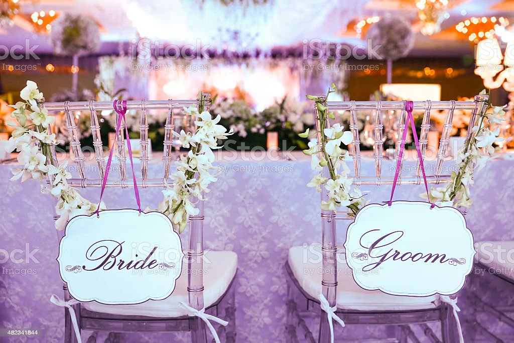 Bride and groom chair at wedding reception stock photo