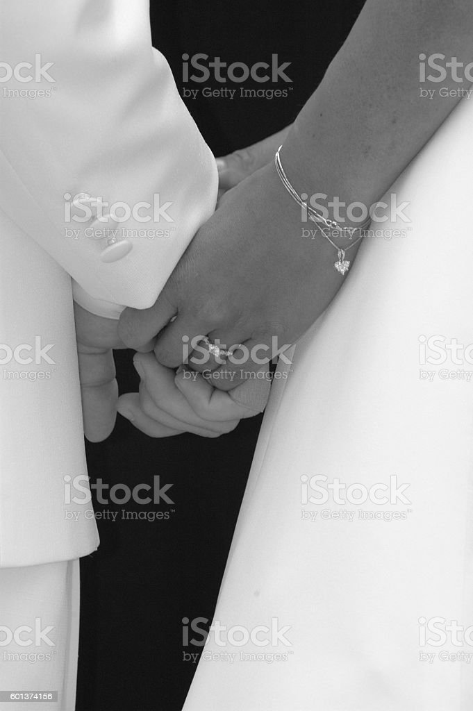 Bride and Groom close-up of holding hands stock photo