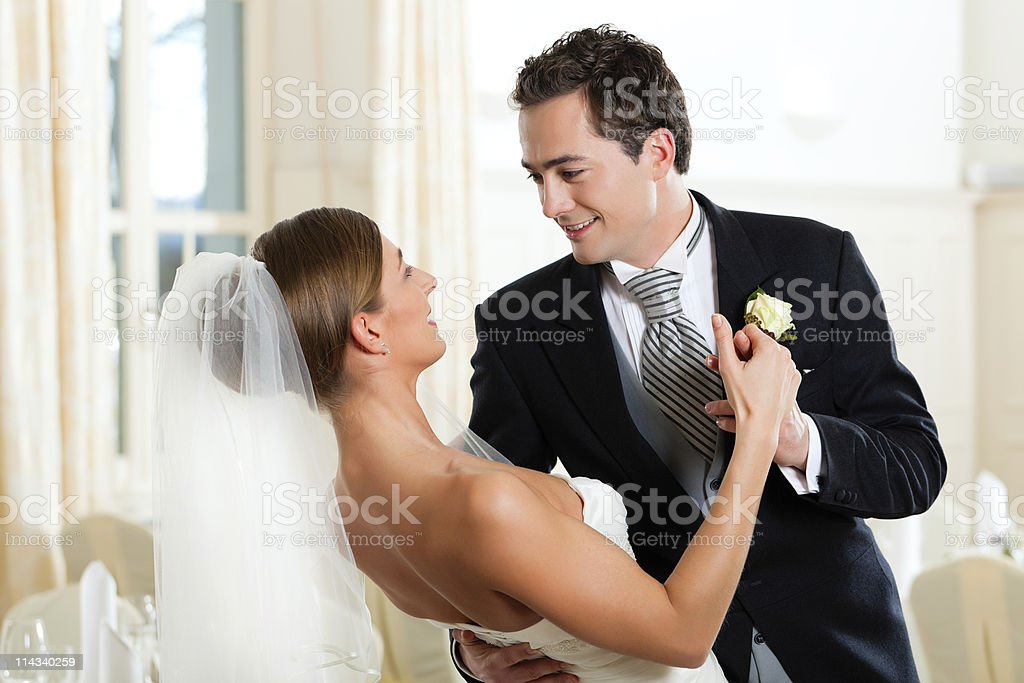 A bride and groom dancing at their wedding royalty-free stock photo