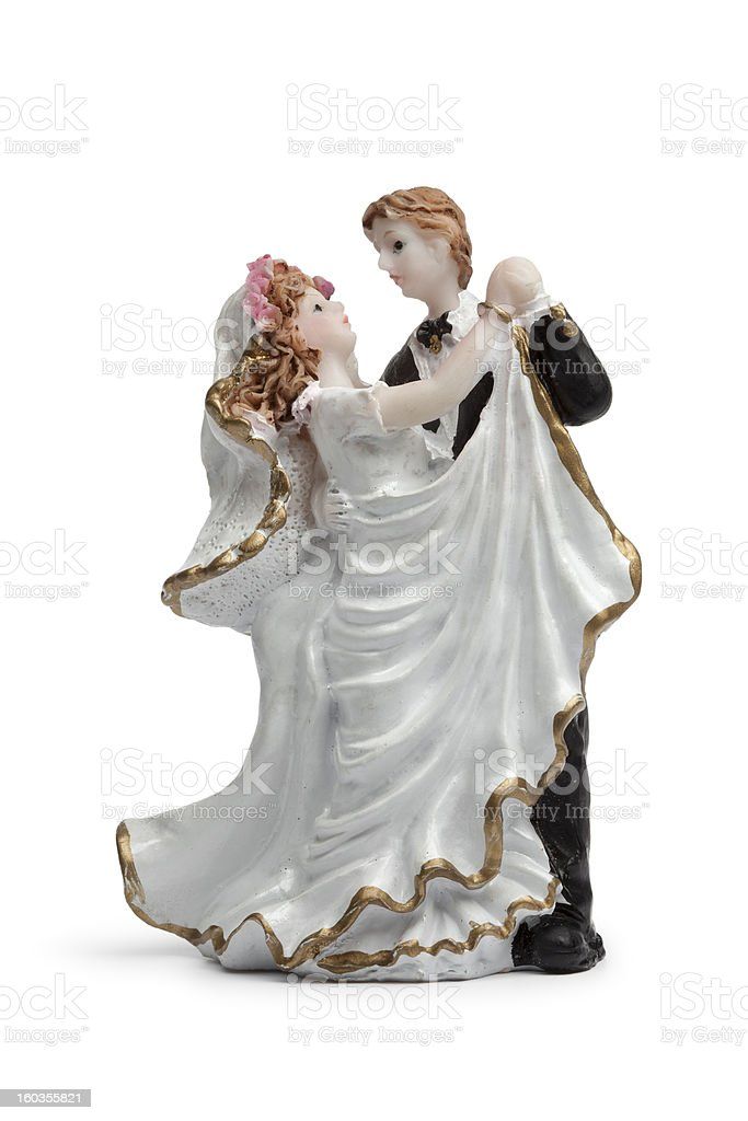 Bride and groom dancing cake topper stock photo