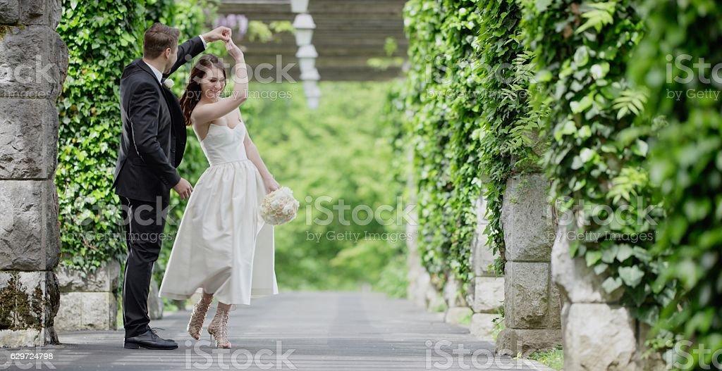 Bride and groom dancing stock photo