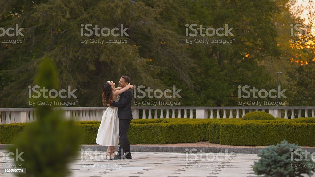 Bride and groom embracing stock photo