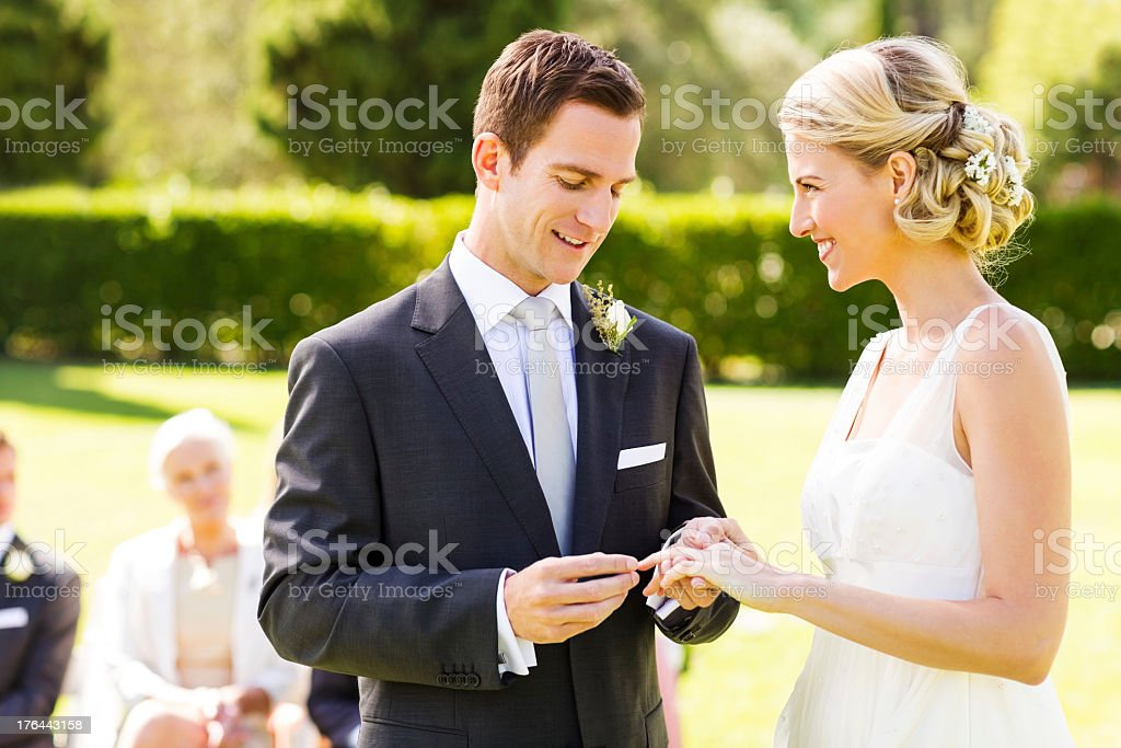 Bride and Groom Exchanging Wedding Ring stock photo