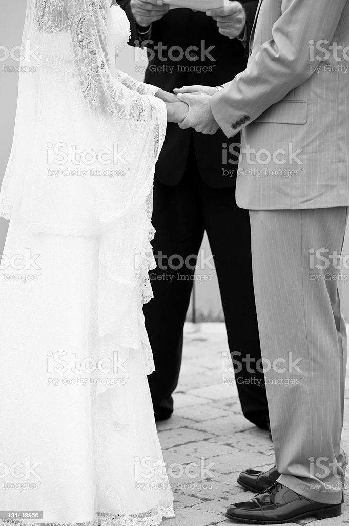Bride and Groom Exhange Vows While Holding Hands royalty-free stock photo