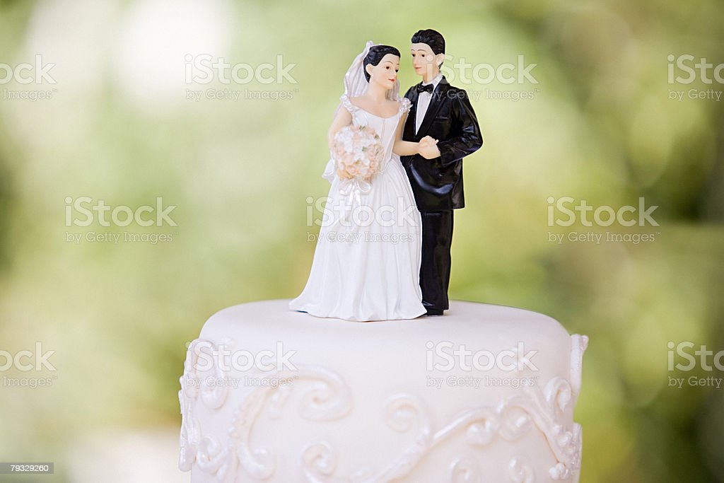 Bride and groom figurines stock photo