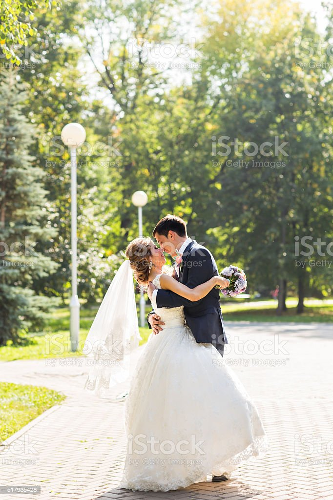 Bride and groom having a romantic moment on their wedding stock photo