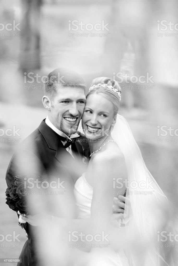 Bride and groom holding each other royalty-free stock photo